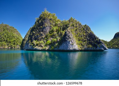The island group of Wayag in Raja Ampat, Indonesia is a spectacular collection of limestone islands.  This area is one of the most biologically diverse on Earth in terms of marine life.