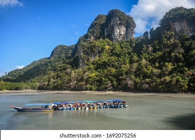 Island Hopping in Langkawi, Malaysia. Scenic views of small green rocky islands from the boat on Andaman Sea.