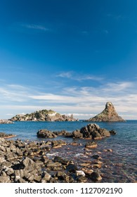 Island Lachea and a sea stack, geological features in Acitrezza (Sicily)
