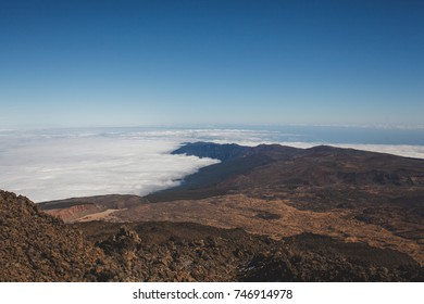 Island landscape from volcano above clouds