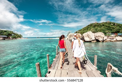 Island lengthwise of the bridge .Water bridge and the sky.Island of dreams .tourists on the island.snorkeling