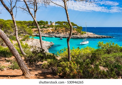 Island Majorca, beautiful paradise bay with turquoise sea water and anchoring boat, Spain summer holiday.
