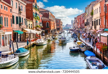 Island murano in Venice Italy. View on canal with boat and motorboat water. Picturesque landscape.