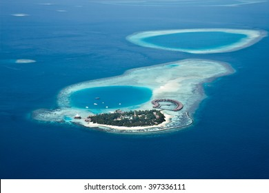 Island in the ocean Maldives  from aerial view.