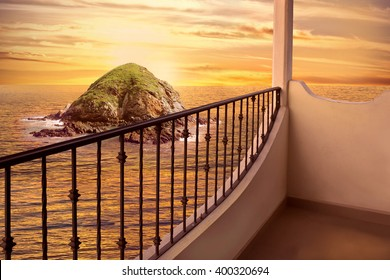 Island in Ocean at Sunset from Balcony