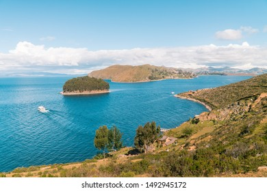Island on Isla del Sol in Bolivia. Scenic panoramic view of island and sea horizon. Bolivian island paradiseand hills. Tourist walking trail, arrival by boat. Local community, tourism. Titicaca lake