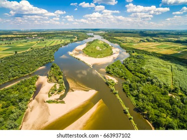 Island on the river. Vistula river and cow island seen from the air. Vistula river with sandy shoals.