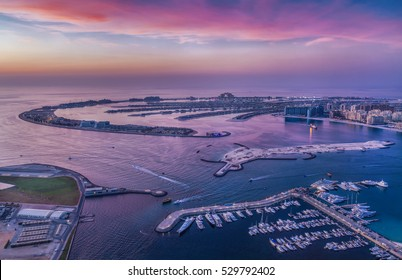 Island Palm Jumeirah from height on sunset background, Dubai, UAE