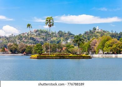 Island with palms on the Kandy Lake in Kandy city, Sri Lanka