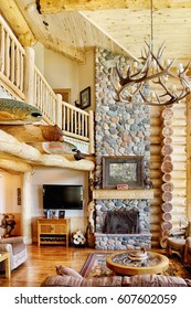 Island Park, Idaho USA  Jul. 28, 2011 The great room in a modern log cabin, with rustic decor, and furniture.