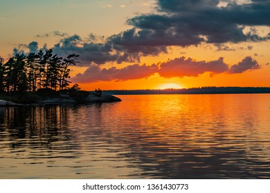 Island in Rainy Lake at Sunset in Summer
