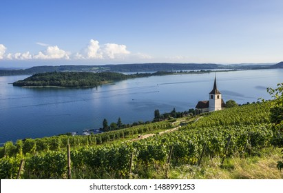 Island of Saint Peter at the lake Biel (Bielersee) and church in Ligerz, Switzerland