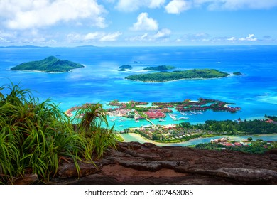 Island Mahé with Sainte Anne Marine National Park, Republic of Seychelles. Capital city Victoria with Island Eden in the foreground.