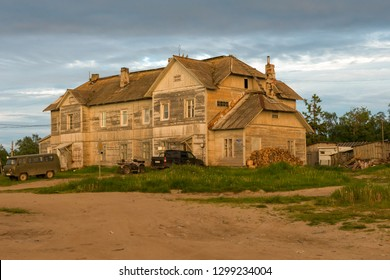 ISLAND SOLOVKI, RUSSIA - JUNE 26, 2018: Barrack of the administration of the Solovki camp. Now residential house in the village of Solovki on a polar summer day, at sunset.  Arkhangelsk region