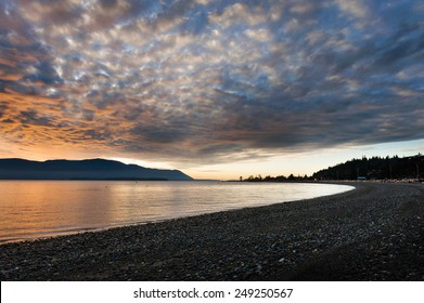 Island Sunset. A dramatic view of Orcas Island, in the Puget Sound area of western Washington, is enveloped in a fiery sunset seen along Legoe Bay on the shores of Lummi Island.
