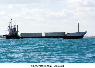 island trading cargo carrier ship near coast