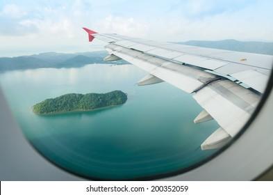 island view through aircraft windows over the sea
