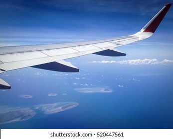 island view through aircraft windows over the sea, bali indonesia
