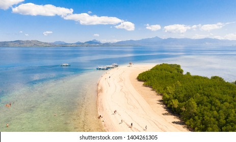 The island of white sand with mangroves. The sea landscape of Honda Bay, view from above. sand bar on coral reefs, Palawan, Philippines.