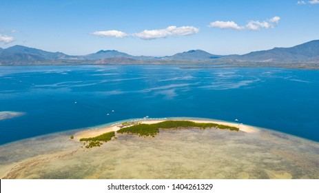 The island of white sand with mangroves. The sea landscape of Honda Bay, view from above. sand bar on coral reefs, Palawan, Philippines.Tropical island with forest on a coral reef, top view.