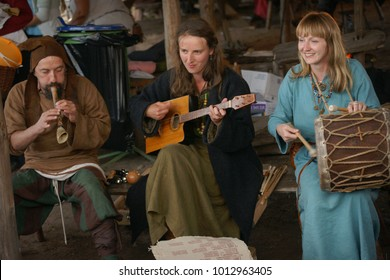 Island Wolin, Poland - August 06 2012: Festival of the Slavs and Vikings, people playing music on traditional Slavs musical instruments