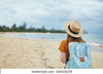 island woman blue sky and sea