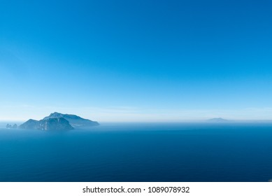 The islands of Capri and Ischia in a clear summer day in Italy