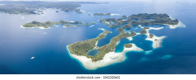 """The islands found throughout Raja Ampat, Indonesia, are surrounded by flourishing coral reefs. This region is known as the """"heart of the Coral Triangle"""" due to its extraordinary marine biodiversity."""