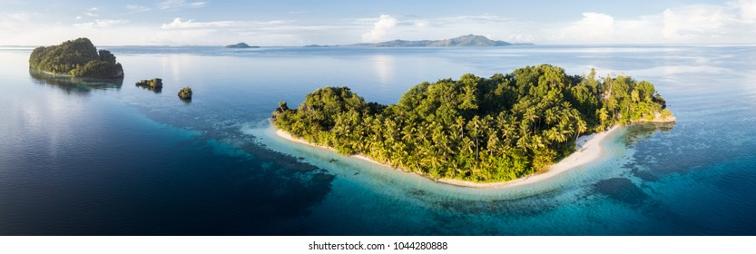 "The islands found throughout Raja Ampat, Indonesia, are surrounded by flourishing coral reefs. This region is known as the ""heart of the Coral Triangle"" due to its extraordinary marine biodiversity."