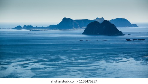 The islands of Mosken and Vaeroy on the Lofoten archipelago in Norway on a sunny summer day.