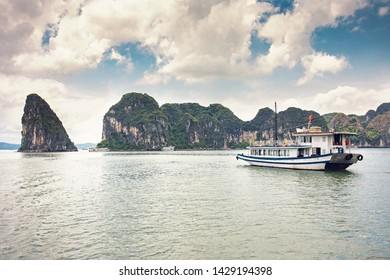 Islands and ship in the sea at famous Ha Long Bay, Vietnam. Halong Bay is one of most popular travel destination on the world.