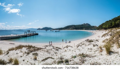 ISLAS CIES, SPAIN - CIRCA SEPTEMBER 2017: Unidentified people relax on the sand beach of Playa de Rodas on the Cies Islands of Spain, included in the Atlantic Islands of Galicia National Park.