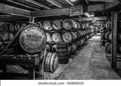 ISLAY, SCOTLAND - JUNE 3, 2014: Whisky maturing in barrels at the famed Laphroaig Distillery, in black and white