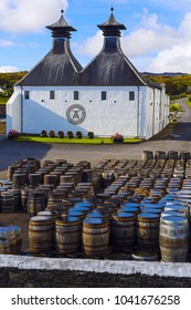 ISLAY, SCOTLAND - SEPT 13 2017: Ardbeg whisky distillery's established in 1815. The traditional white painted building with black double tower roof.