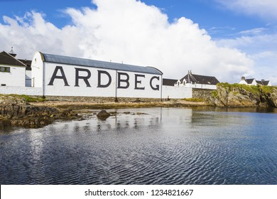 ISLAY, SCOTLAND - SEPT 13 2017: Ardbeg whisky distillery's established in 1815. The traditional white painted building with black inscription of the brand's name on it.