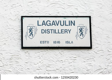 ISLAY, SCOTLAND - SEPT 13 2017: Lagavulin whisky distillery signboard on the warehouse wall. This single malt Scotch production company was established in 1816.