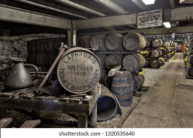 ISLAY, SCOTLAND - SEPT 15 2017 : Old wooden barrels and casks at Lafroaig whisky distillery warehouse established in 1815.