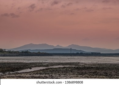 The Isle of Arran from Fairlie sandy shore line after the sun goes down in Scotland.