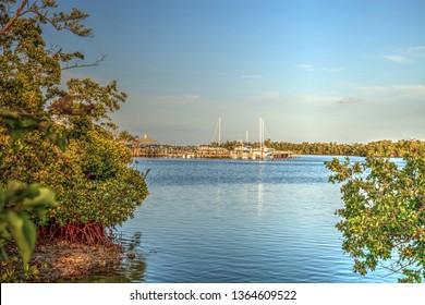 Isle of Capri, Florida, USA – March 5, 2019: Marina in Isle of Capri entrance to the marina at sunset.
