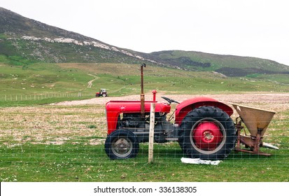 Isle of Lewis, Outer Hebrides, UK, June 8 2015: Vintage red tractor in a field in UK