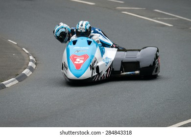 ISLE OF MAN, UK - MAY 30: 2 riders in the sidecar category undertake their first official practice laps of the annual TT (Tourist Trophy) race on 30 May 2015 in the Isle of Man (Public Event)