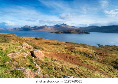 The Isle of Mull coastline at Acharonich, looking out over the small isle of Eorsa to the Ben More mountains