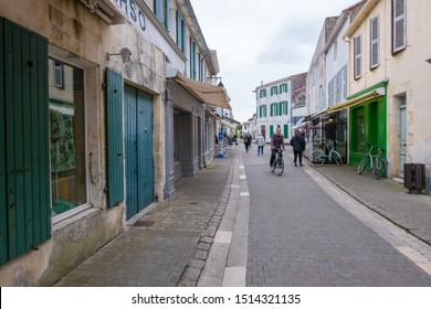 Isle of Re, France - May 09, 2019: A street of La Flotte village on Ile de Re island in France. It is one of the most beautiful villages in France