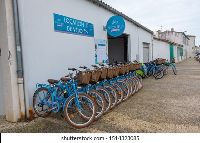 Isle of Re, France - May 09, 2019: Bike renting on the street of La Flotte village on Ile de Re island in France.