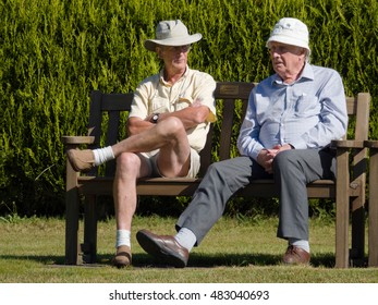 ISLE OF THORNS, SUSSEX/UK - SEPTEMBER 11 : Spectators at a Lawn Bowls Match at Isle of Thorns Chelwood Gate in Sussex on September 11, 2016. Unidentified men