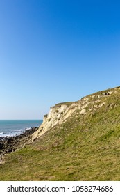 Isle of Wight landscape, St Catherine's Lighthouse area in sunny day, with bright green grass andclear blue sky
