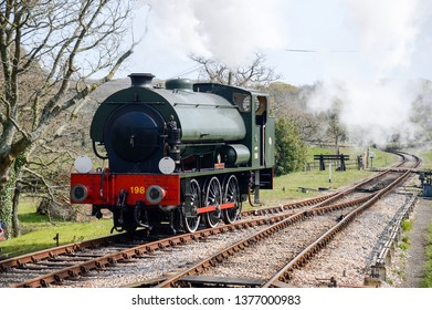 Isle of Wight, UK - April 2019 : Historic steam engine and railway line in Isle of Wight now used as a visitor attraction