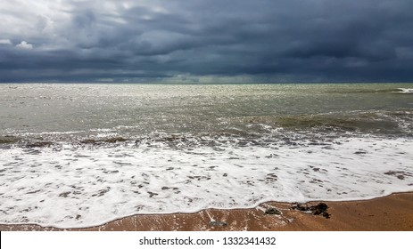Isle of Wight, United Kingdom - August 28, 2018:  stormy sky and waves on a beach