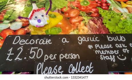 Isle of Wight, United Kingdom - August 28, 2018:  Decorating garlic bulbs at Garlic Farm, populat toutist destination