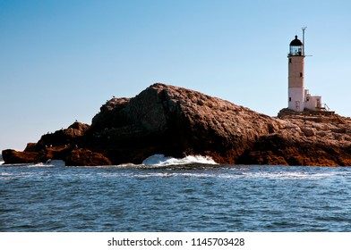 Isles of Shoals lighthouse, also referred to as White Island light, sits above jagged rocks on the New Hampshire seacoast.
